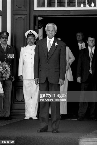Former President Nelson Mandela of South Africa greats people outside Tuynhuys the presidential official office on February 18 1998 in Cape Town...