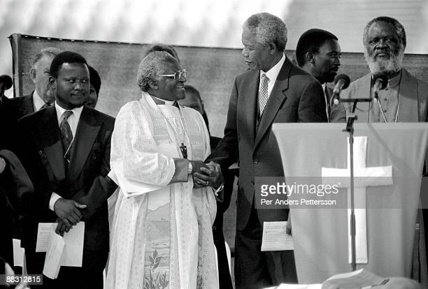 Former President Nelson Mandela of South Africa greets Desmond Tutu at a preelection rally weeks before the historic democratic election on April 15...