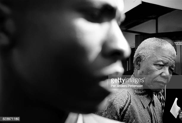 Former President Nelson Mandela of South Africa greets school children during a election stop on May 1, 1999 in Eastcourt, South Africa. The ANC...