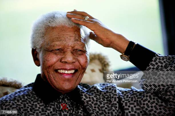 Former President Nelson Mandela of South Africa relaxes while on holiday on June 14, 2006 in Maputo, Mozambique. He is retired and takes time off...
