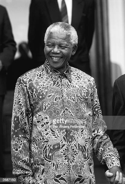 Former President Nelson Mandela of South Africa smiles as he greats people outside his home September 25 1998 in Pretoria South Africa The ANC...