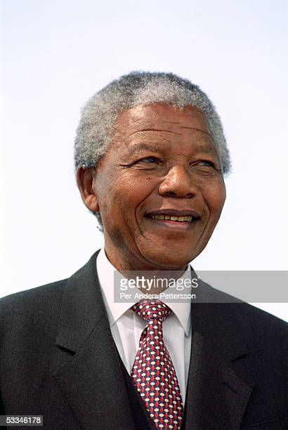 Former President Nelson Mandela of South Africa smiles as he greats people at a preelection rally weeks before the historic democratic election on...