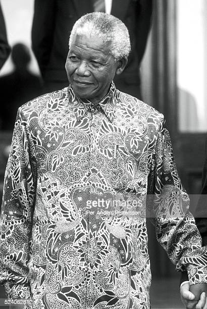 Former President Nelson Mandela of South Africa smiles as he greets people outside his home September, 25 1998 in Pretoria, South Africa. The ANC...