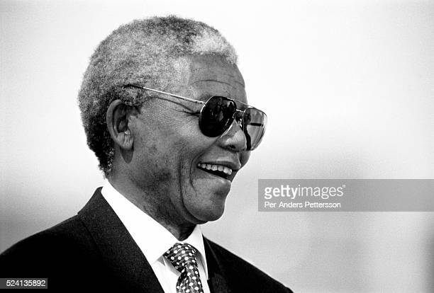Former President Nelson Mandela of South Africa smiles as he greets people at a pre-election rally weeks before the historic democratic election on...