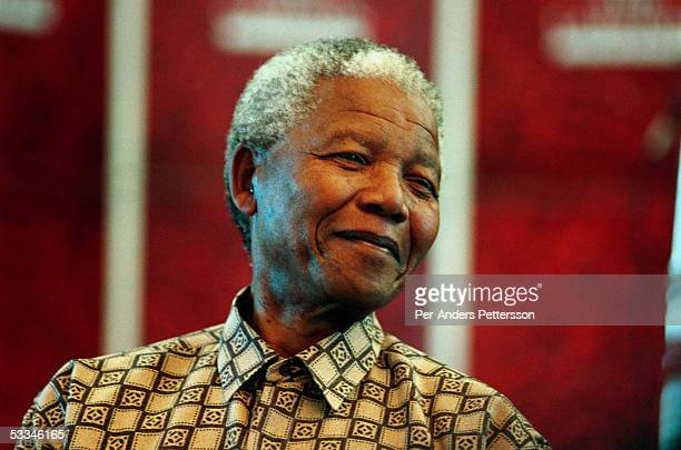 Former President Nelson Mandela of South Africa smiles as he talks to visitors on March 8 1999 in his residence in Houghton a suburb of Johannesburg...