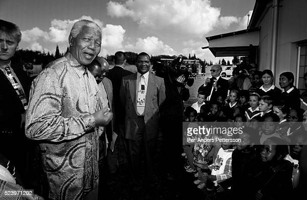 Former President Nelson Mandela of South Africa speaks to school children during a election stop on May 1, 1999 in Eastcourt, South Africa. The ANC...