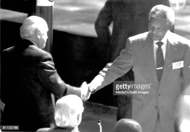 Former President Nelson Mandela shakes hands with FW de Klerk at Codesa