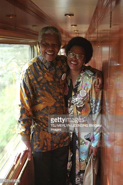 Former president Nelson Mandela with his wife Graca Machel during a journey on the Blue Train