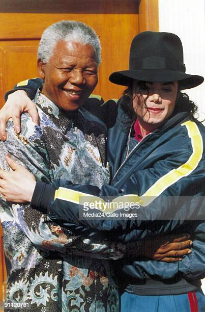 Former President Nelson Mandela with the King of Pop Michael Jackson during the King of Pop's SA visit