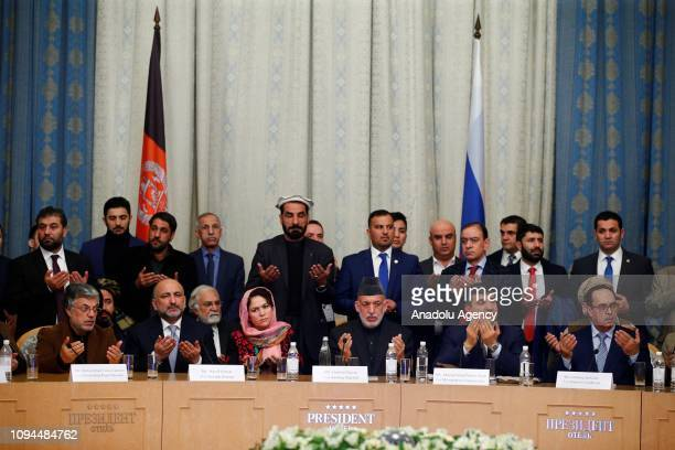 Former President of Afghanistan Hamid Karzai prays after the manifesto following the peace talks on Moscow format at the President Hotel in Moscow...