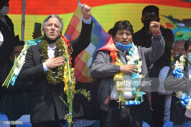 Former president of Bolivia Evo Morales and former vice president of Bolivia Alvaro Garcia Linera greet supporters during a welcoming ceremony for...