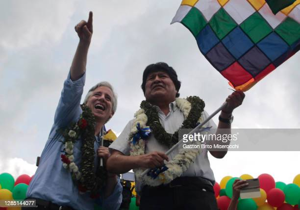 Former president of Bolivia Evo Morales and former vice-president Alvaro García Linera wave a wiphala flag and greet supporters on their arrival...