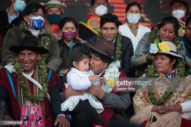 Former president of Bolivia Evo Morales holds a child during a welcome ceremony at Santa Rosa neighborhood on December 3, 2020 in El Alto, Bolivia....