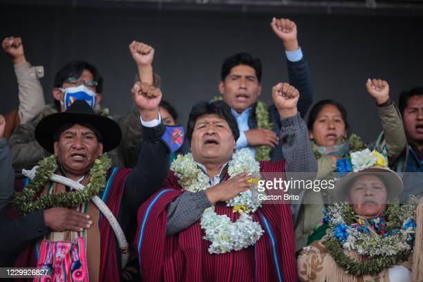 Former president of Bolivia Evo Morales rise left fist and chants during a welcome ceremony at Santa Rosa neighborhood on December 3, 2020 in El...