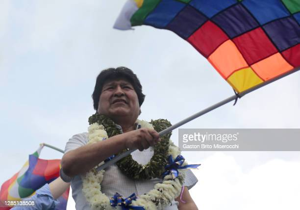 Former president of Bolivia Evo Morales waves a wiphala flag on his arrival after one year of political exile on November 11, 2020 in Chimoré,...