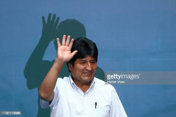 Former President of Bolivia Evo Morales waves during an event to distinguish him as honorary guest at City Hall on November 13 2019 in Mexico City...