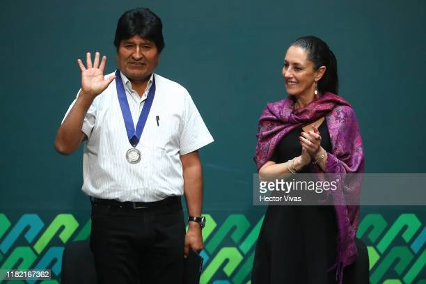 Former president of Bolivia Evo Morales waves to the press along with Mayor of Mexico City Claudia Sheinbaum after being distinguished as honorary...
