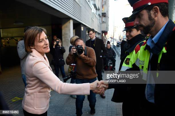 Former president of Catalan parliament and 'Esquerra Republicana de Catalunya' ERC candidate Carme Forcadell shakes hands with members of the Catalan...