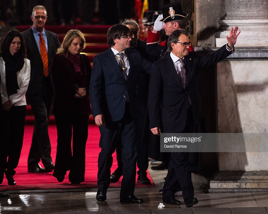 Former President of Catalonia Artur Mas (R) acknowledges the crowd next to the new president Carles Puigdemont (C) as they leave the Generalitat Palace, house of the Catalan government, on January 12, 2016 in Barcelona, Spain. Three months after the Catalan Elections, Carles Puigdemont took office as the 130th President of Catalonia. Puigdemont will replace the former Catalan President Artur Mas as part of the agreement closed last week with the radical left-wing party CUP to form a new government.