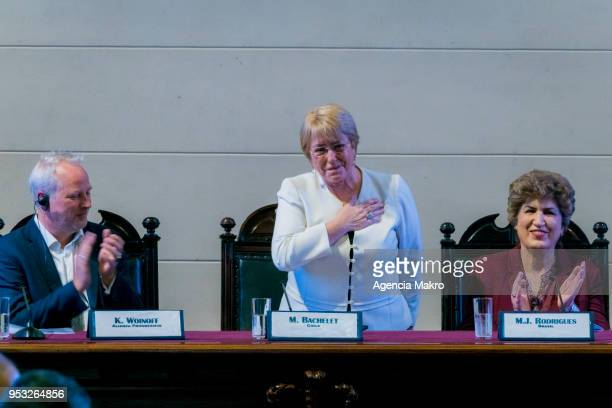 Former President of Chile Michelle Bachelet salutes during the ceremony Progressive Alliance 2018 at the headquarters of the former Congress of Chile...