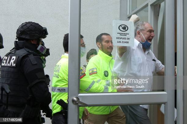 Former President of Ecuador Abdalá Bucaram reacts as he enters the Judicial Police surrounded by police officers on June 3 2020 in Guayaquil Ecuador...