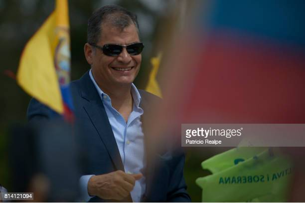 Former President of Ecuador Rafael Correa greets supporters at his arrival to Mariscal Sucre Airport on July 10 2017 in Quito Ecuador Rafael Correa...