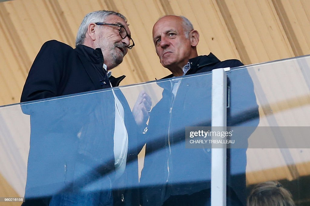 Former president of French football club Caen Jean-Francois Fortin (L) talks with journalist Jean-Michel Apathie before before the French L1 football match between Caen (SMC) and Paris Saint-Germain (PSG), at the Michel d'Ornano stadium, in Caen, northwestern France on May 19, 2018.