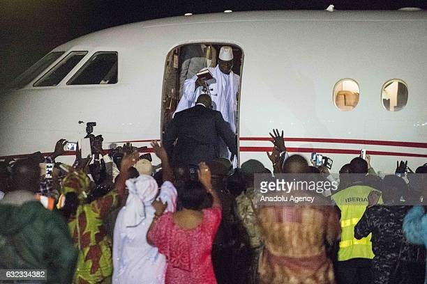 Former president of Gambia, Yahya Jammeh, the Gambia's leader for 22 years, waves to his supporters from the plane as he leaves the country,...
