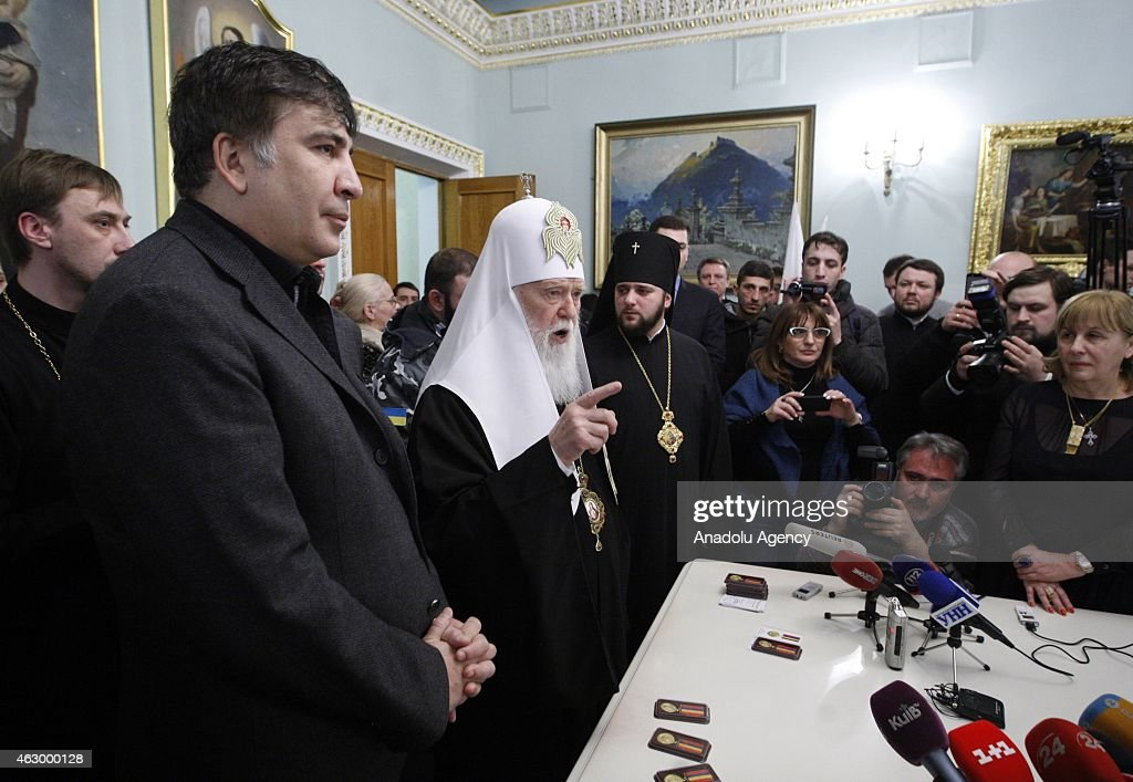 Former president of Georgia Mikheil Saakashvili (2nd L) and Patriarch Filaret (3rd L) attend a ceremony held for the 29 volunteer Georgian people fighting against the pro-Russian separatists, in Kiev, Ukraine on February 08, 2015. Volunteers are granted with an award for their sacrifices for Ukraine's peace during the ceremony.