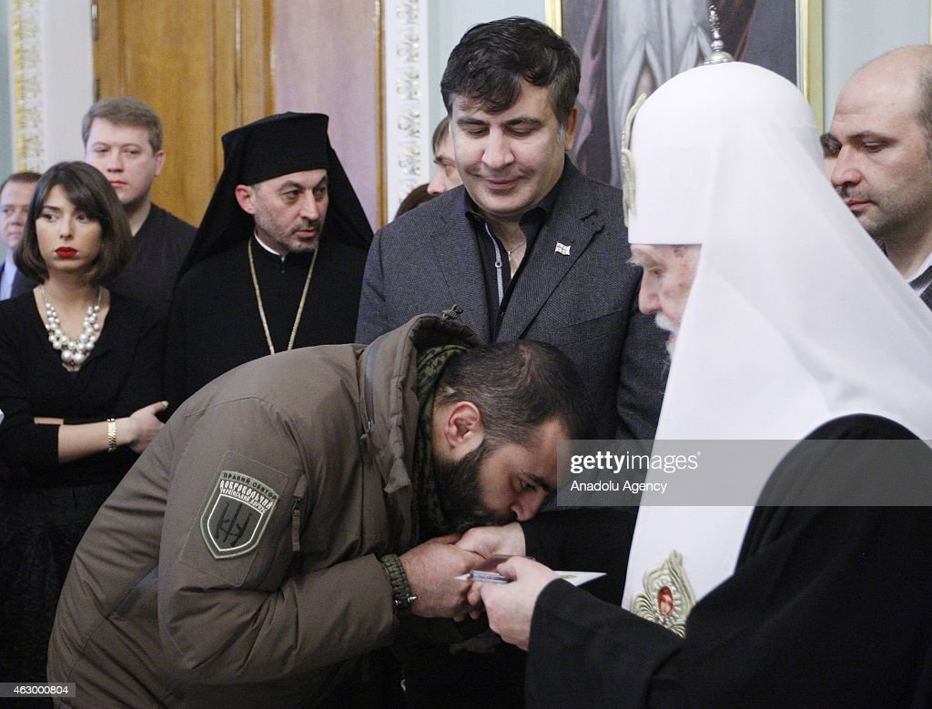 Former president of Georgia Mikheil Saakashvili (3rd R) and Patriarch Filaret (2nd R) attend a ceremony held for the 29 volunteer Georgian people fighting against the pro-Russian separatists, in Kiev, Ukraine on February 08, 2015. Volunteers are granted with an award for their sacrifices for Ukraine's peace during the ceremony.