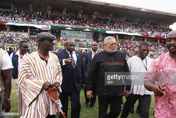 Former President of Ghana Jerry John Rawlings arrives at the Baba Yara stadium in Kumasi on August 30 2012 Ghana's ruling National Democratic...