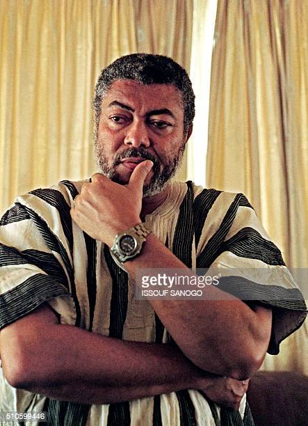 former president of Ghana Jerry Rawlings poses in his villa 07 May 2001 in Accra Rawlings who seized power in a 1981 coup legitimized his rule in...