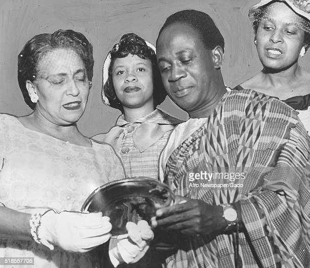 Former president of Ghana Kwame Nkrumah, Lorraine Williams and two women presenting gifts, 1957.