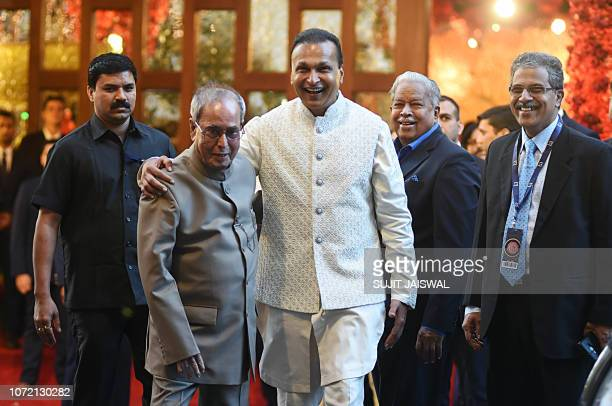 Former President of India and Indian businessman Anil Ambani attend the wedding ceremony of Indian businesswoman Isha Ambani with Indian businessman...