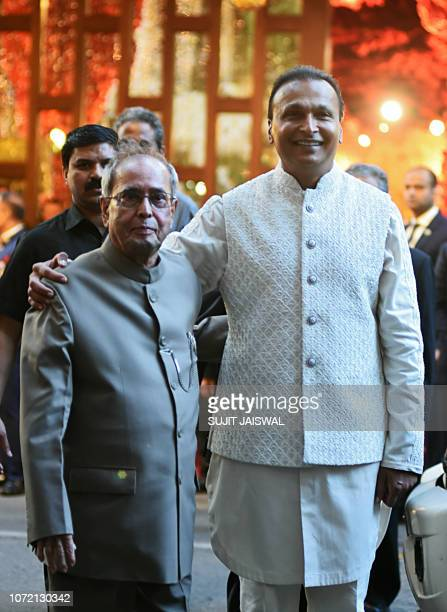Former President of India and Indian businessman Anil Ambani pose for a picture as they attend the wedding ceremony of Indian businesswoman Isha...