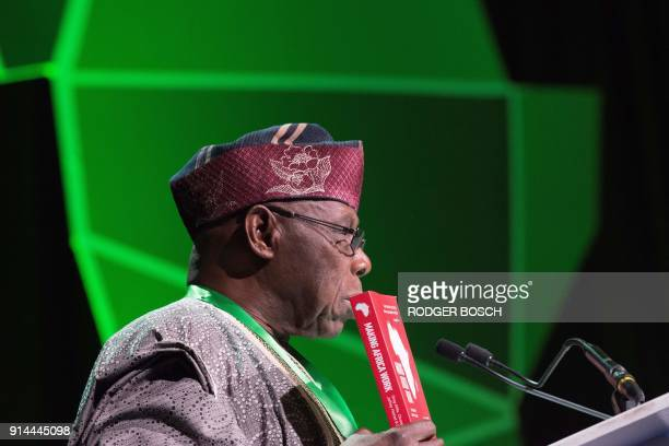 Former president of Nigeria and chairman of the Brenthurst Foundation Olusegun Obasanjo delivers a speech as he holds a book during the 2018...