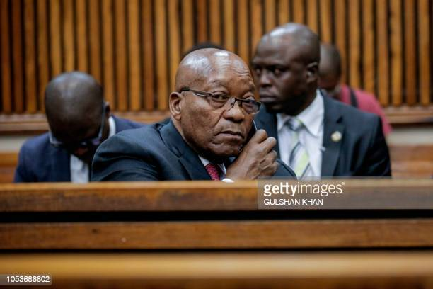 Former President of South Africa, Jacob Zuma speaks on the phone at the Randburg Magistrates Court on October 26 in Johannesburg, where his son...