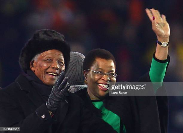 Former President of South Africa Nelson Mandela and his wife Graca Machel smile and wave to the crowd ahead of the 2010 FIFA World Cup South Africa...