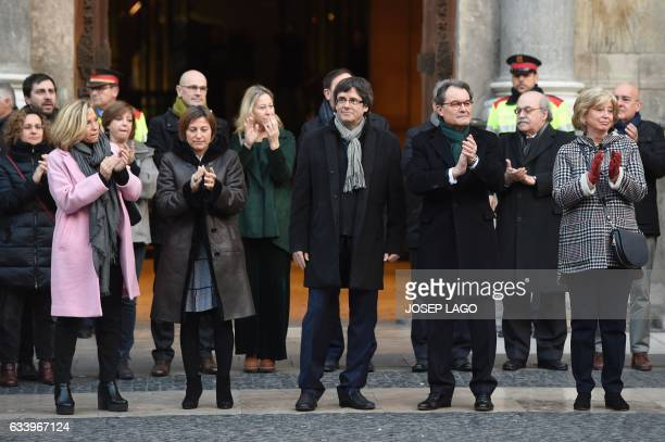Former President of the Catalan Government and leader of Partit Democrata Europeu Catala PDECAT Artur Mas applauds past President of the Catalan...