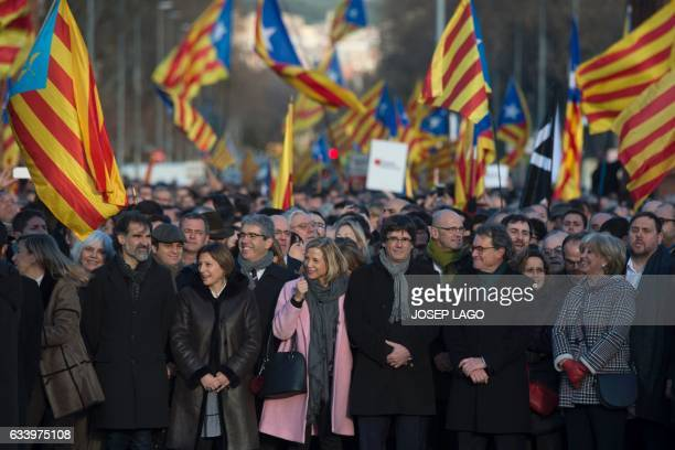 Former President of the Catalan Government and leader of Partit Democrata Europeu Catala PDECAT Artur Mas poses with President of the Catalan...