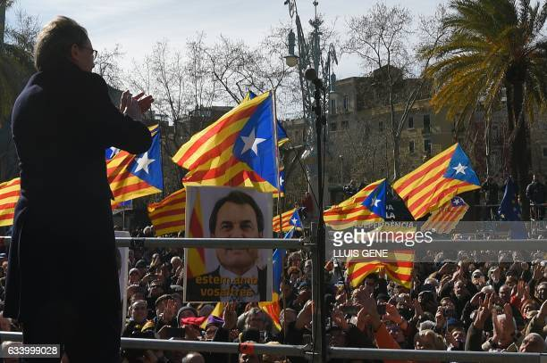 Former President of the Catalan Government and leader of Partit Democrata Europeu Catala PDECAT Artur Mas applauds his supporters after leaving the...
