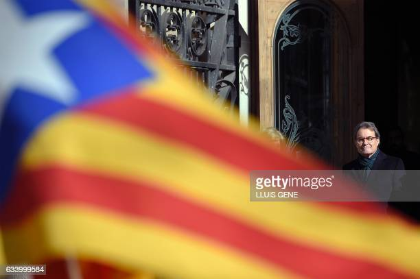 Former President of the Catalan Government and leader of Partit Democrata Europeu Catala PDECAT Artur Mas looks at his supporters after leaving the...
