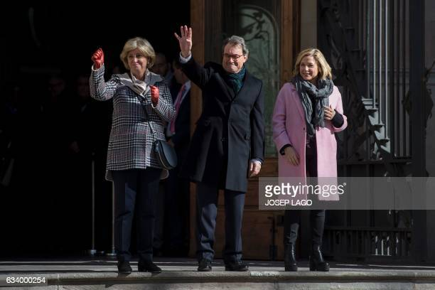 Former President of the Catalan Government and leader of Partit Democrata Europeu Catala PDECAT Artur Mas waves to his supporters past former...