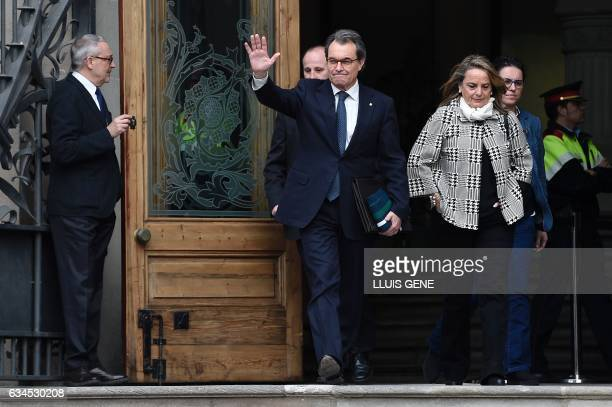 Former President of the Catalan Government and leader of Partit Democrata Europeu Catala PDECAT Artur Mas and and his wife Helena Rakosnik waves as...