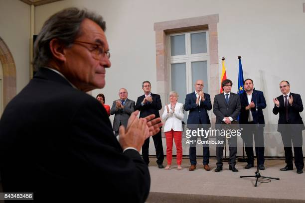 Former President of the Catalan Government and leader of Partit Democrata Europeu Catala PDECAT Artur Mas applauds President of the Catalan...