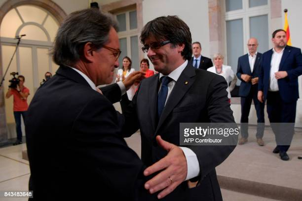 Former President of the Catalan Government and leader of Partit Democrata Europeu Catala PDECAT Artur Mas congratulates President of the Catalan...