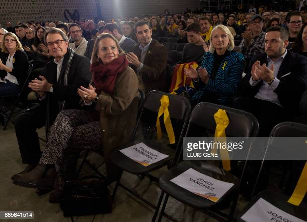 Former President of the Catalan Government and leader of Partit Democrata Europeu Catala PDECAT Artur Mas and and his wife Helena Rakosnik sit next...