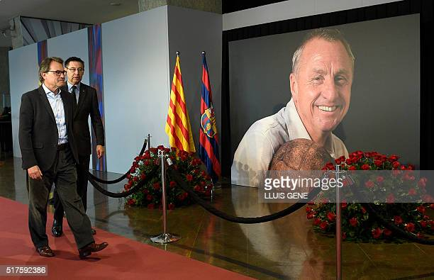 Former President of the Catalan Government Artur Mas arrives with FC Barcelona's president Josep Maria Bartomeu to pay tribute to late Dutch football...