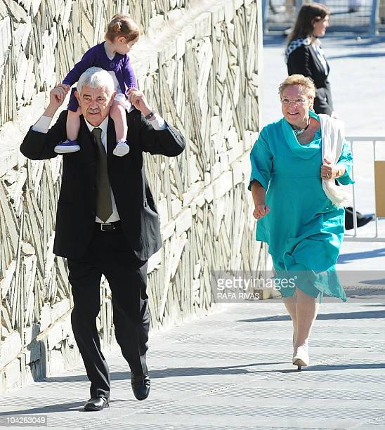 Former president of the Catalan government Pasqual Maragall is followed by his wife Diana Garrigosa as he arrives with his grandaughter Maya to take...