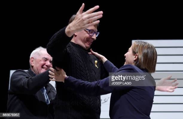 Former president of the Catalan parliament Carme Forcadell hugs deposed Catalan regional government justice chief Carles Mundo during the campaign...
